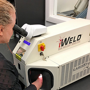 Jeweler using state of the art equipment to evaluate estate jewelry