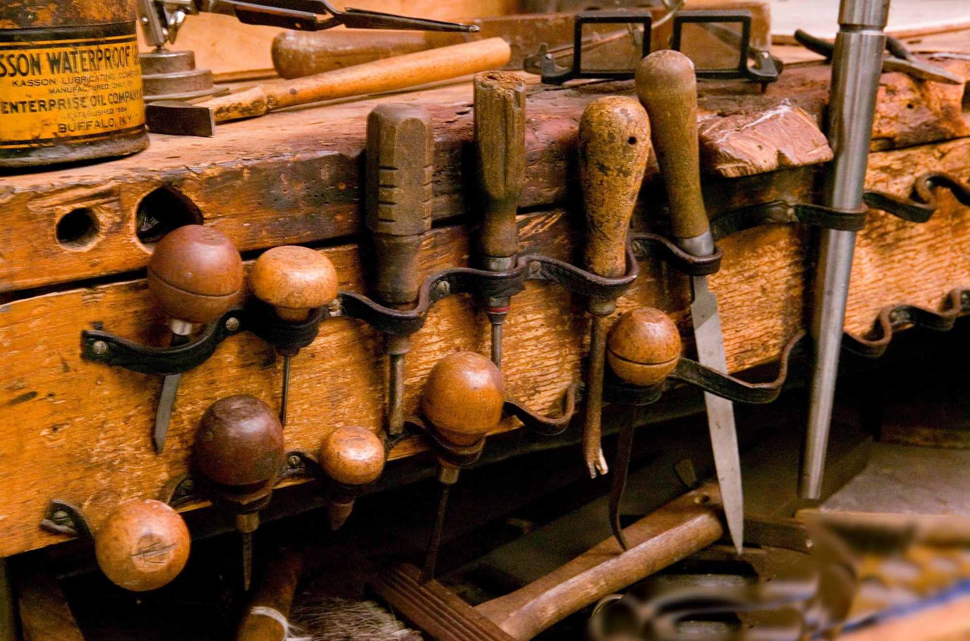 Workbench showing jewelry repair tools organized on hooks