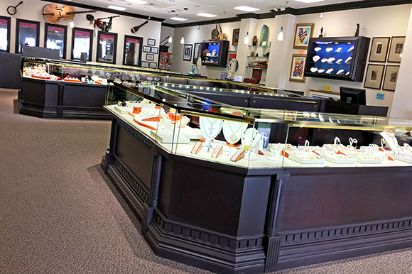 Interior of National Pawn & Jewelry showing jewelry store quality display cases of items available